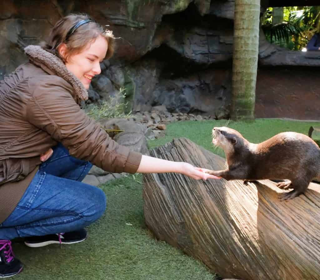 Nicole Watson interacting with an otter
